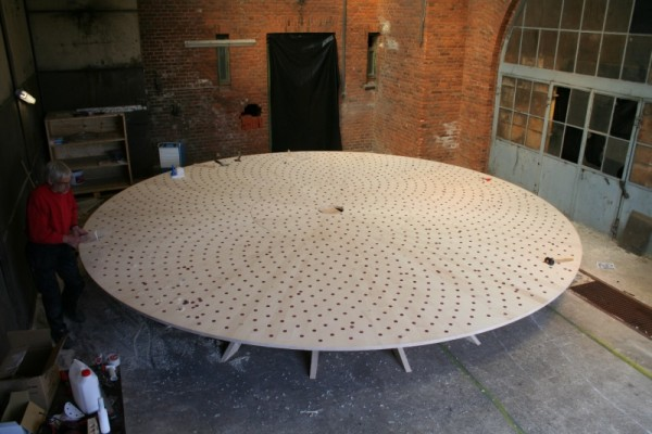 The conference table being sanded